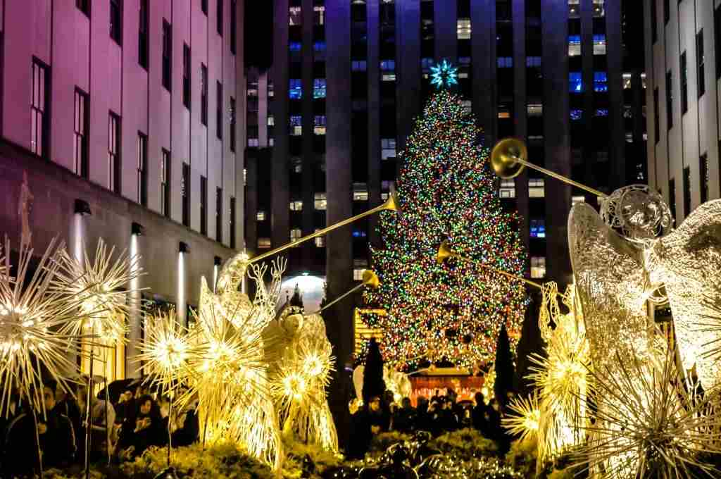 big christmas tree with light in front of the Rockefeller center - Travelistia